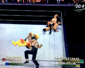 Famous wrestlers fight in a ring in WWE Raw 2 for Xbox